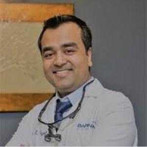 Dr. Dharam Tayal